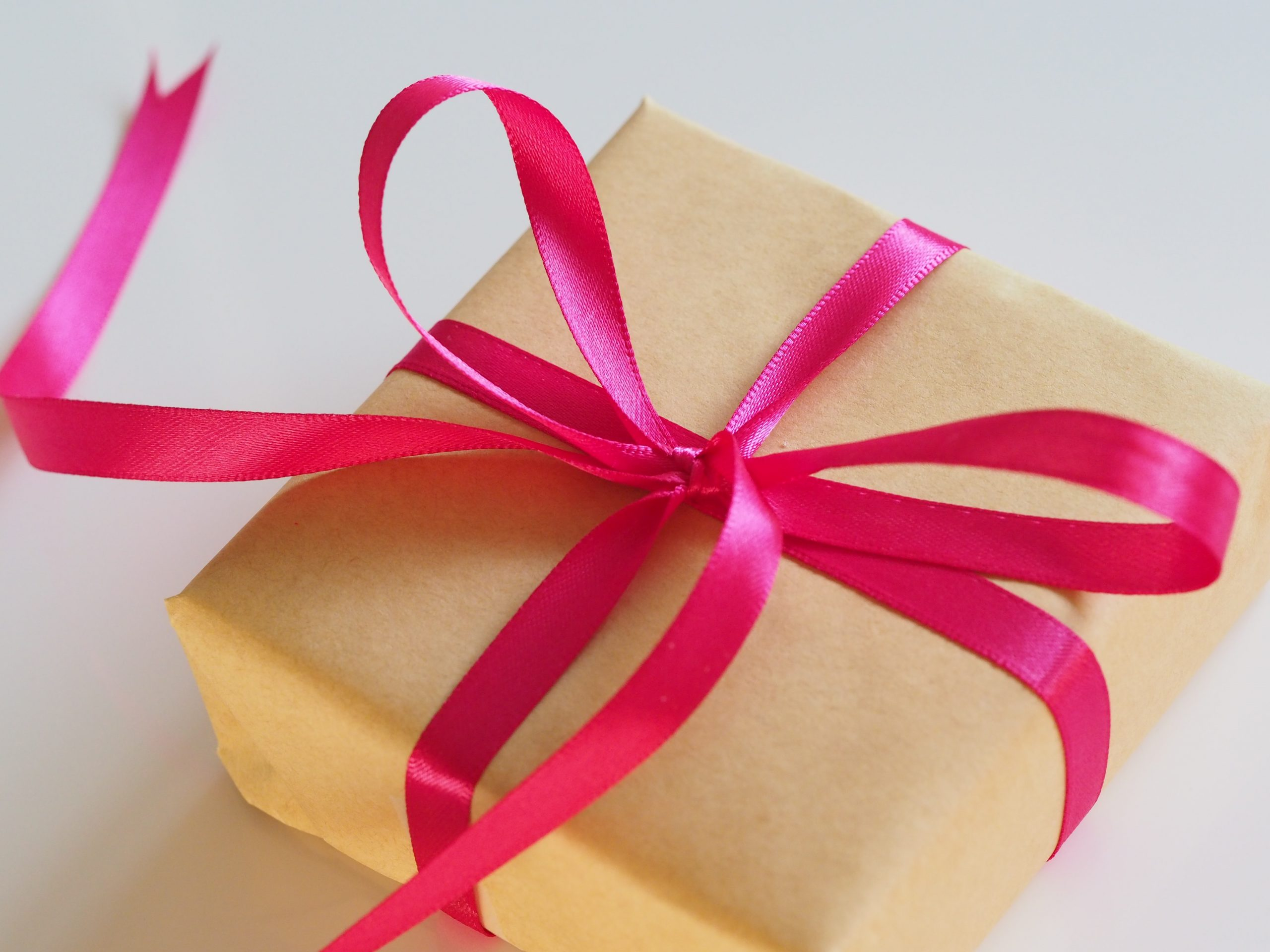 What is the symbolic meaning of perfume as a gift?